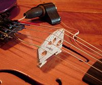 Piezoelectric violin bridge pickup