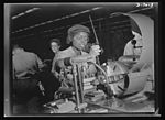 Plant foremen point to 20-year-old Annie Tabor as one of their best lathe operators 8b07728v.jpg