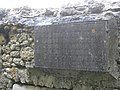 Port-Royal-des-Champs - inscription sur mur entre cloître et abbatiale.jpg