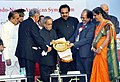Pranab Mukherjee being presented a memento at the inauguration of the 66th annual session of Indian Institute of Chemical Engineers (IIChE), CHEMCON 2013, at Institute of Chemical Technology.jpg