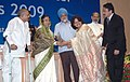 Pratibha Devisingh Patil giving away the National Urban Water Awards 2009 to Smt. Neerja, Additional Chief Secretary and Chairperson of Karnataka Urban Infrastructure Development and Finance Corporation, in New Delhi.jpg