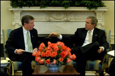 President George W. Bush meets with Attorney General John Ashcroft in 2003