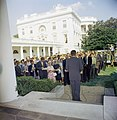 President John F. Kennedy greets the first group of Peace Corps Volunteers going to Tanganyika and Ghana, in the White House Rose Garden - KN-C18661-C.jpg