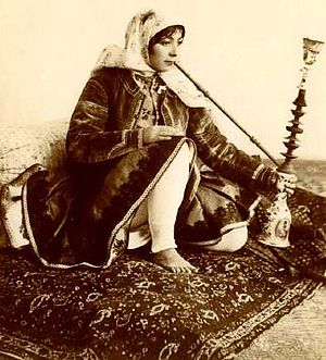 Mu'assel - Persian woman in Qajari dress smoking the traditional Qalyan