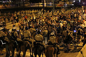 2012 Republican National Convention - Police surround protestors during a nighttime demonstration on August 30
