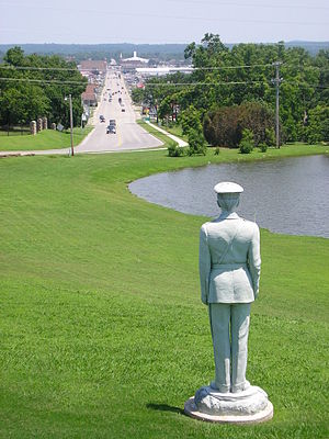 Rogers State University - A statue of a soldier dating from RSU's time as Oklahoma Military Academy overlooks Claremore from the school's entrance.