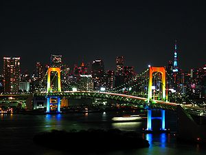 Rainbow colored Rainbow Bridge at night.jpg