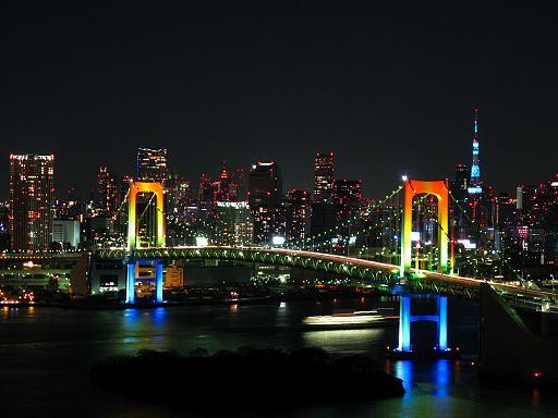 Rainbow colored Rainbow Bridge at night