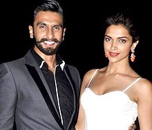 Ranveer Singh and Deepika Padukone smiling for the camera