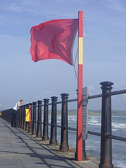 Red flag at a beach in Ireland, indicating that the water is not safe for swimming Red flag at beach.jpg
