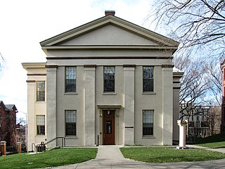 Rhode Island Hall on the College Green, built 1839-40, designed by James Bucklin in Greek Revival style to house the Natural History department, is now home to the Joukowsky Institute for Archaeology
