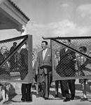 Robert-Taylor-with-a-group-of-people-entering-the-gate-of-Hipodromo-de-la-Zarzuela-352039176361.jpg