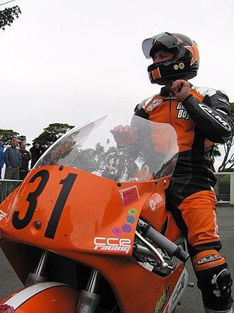 2012 Manx Grand Prix - Winners Enclosure 2012 Junior Post Classic Manx Grand Prix – Roy Richardson (31) 250 cc Yamaha TT Grandstand Friday 31 August 2012