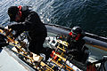 Royal Canadian Navy Leading Seamen Chris McAllister and Nick Lindstrom disembark the maritime coastal defense vessel HMCS Summerside (MM 711) and board a rigid hull inflatable boat to conduct mine 120504-N-IL267-005.jpg