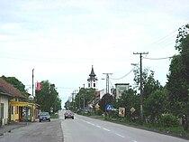 Rumenka, main street and Orthodox church.jpg