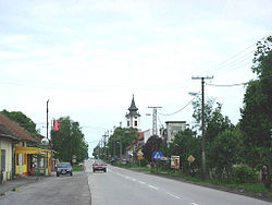 Rumenka, main street and Orthodox church.jpg