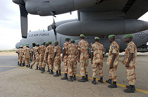 Rwandan peacekeepers prepare to board a U.S. A...
