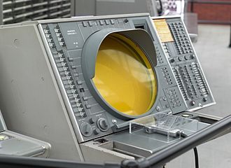 Semi-Automatic Ground Environment -  The AN/FSQ-7 had 100 system consoles, including the OA-1008 Situation Display (SD) with a light gun (at end of cable under plastic museum cover), cigarette lighter, and ash tray (left of the light gun).