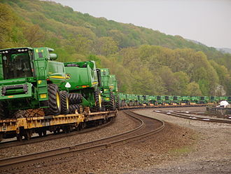Tyrone, Pennsylvania - John Deere Combine harvester's being transported by railway on flatcars in Tyrone, Pennsylvania.