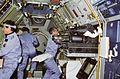 STS-9 crewmembers work in the Spacelab 1 module.jpg