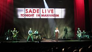 Sade (singer) - Sade and band at the SAP Arena, Germany, in 2011
