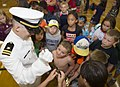 Sailor interacts with local children during a community relations event. (35799122513).jpg