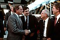 Sam Nunn and William Ball greet two members of the crowd on hand for the arrival of the nuclear-powered strategic missile submarine USS TENNESSEE (SSBN 734).jpg