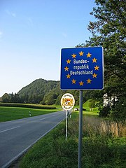 A typical Schengen border crossing has no border control post and only a common EU-state sign welcoming the visitor, as here between Germany and Austria. The sign announces entry to the Federal Republic of Germany in German.