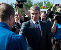 Sergei Krikalev shakes hands and welcomes home Expedition 27.jpg
