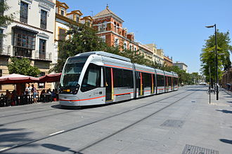 Acumulador de Carga Rápida - An ACR-equipped Urbos 3 tram running through central Seville without overhead line, 2015. The supercapacitor batteries are visible on the roof of each end car.