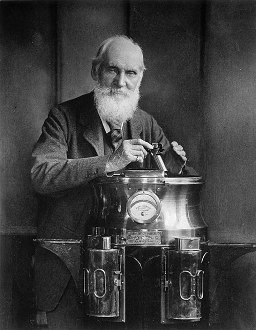 Sir William Thomson, Baron Kelvin, 1824 - 1907. Scientist, resting on a binnacle and holding a marine azimuth mirror.jpg