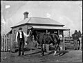 Small cottage with mounted horseman (3054176293).jpg