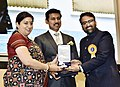 Smriti Irani presenting the Rajat Kamal Award to Varun Shah (Best Debut Film of a Director) for the Non-Feature film – WATERBABY, at the 65th National Film Awards Function, in New Delhi.JPG