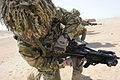 Soldier from A Company 1 Royal Anglian Checking his Gun in Afghanistan MOD 45154068.jpg