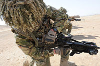 Soldier from A Company 1 Royal Anglian Checking his Gun in Afghanistan MOD 45154068