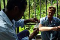 Solomon Water volunteer and his counterpart Josh Torenn test for particles in Honiara's main water supply at the Kongulai water source. (10721647974).jpg