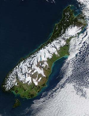 Alpine Fault - Snow delineates the escarpment formed by the Alpine Fault along the Southern Alps' northwest edge, near the South Island's west coast. This satellite image shows the aftermath of a blizzard that hit the island in July 2003.