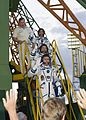 Soyuz TMA-05M crew members wave farewell.jpg