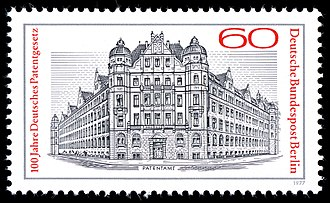 Deutsches Patent- und Markenamt - 1977 stamp showing the Patent Office from 1877 to 1977. Picture of the new Patent Office building in 1905 on Gitschiner Road