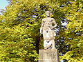 Statue of Man with Child and Trees.jpg