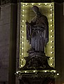 Statue of St. Augustine with Christmas decor.jpg