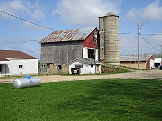 Bank barn - This bank barn in Illinois has a ramp of dirt and stone.