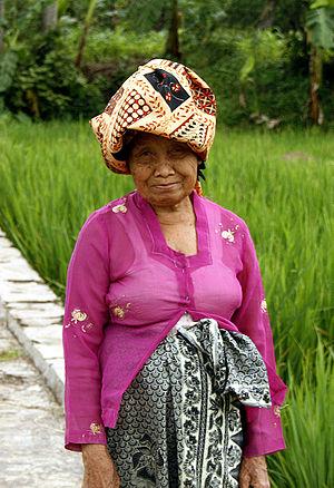 Kebaya - An elderly Sundanese woman wearing simple kebaya, kain batik and batik headcloth, West Java.