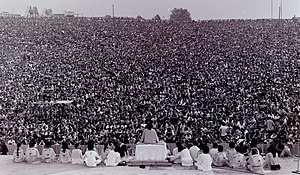 Satchidananda Saraswati - Swami Satchidananda on stage at the 1969 Woodstock Festival