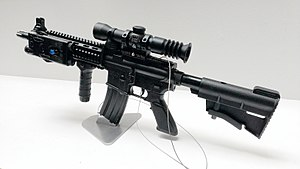 T91 assault rifle - The T91CQC carbine.  Note the forend with integrated rails and the shorter barrel compared to the standard variant.