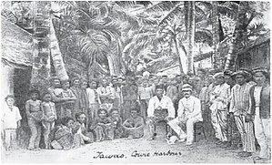 Tawau - Tawau residents and their community chief with Alexander Rankin Dunlop (sitting right) in the Cowie Harbour of Tawau, circa 1885.