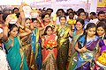 """The District Magistrate and District Collector, Nizamabad, Smt. Dr.Yogitha Rana with the School Children, in traditional """"Bathukamma"""" costumes at the inauguration of the Public Information Campaign, at Armoor.jpg"""