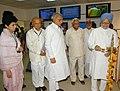The Prime Minister, Dr. Manmohan Singh lighting the lamp to Dedicate the EDUSAT- Satellite based educational programme at Village Khedar, Hisar District in Haryana on May 19, 2007.jpg