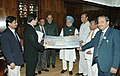 The Union Minister for Shipping, Road Transport and Highways, Shri T. R. Baalu presenting a cheque of Rs.504 crore to the Prime Minister, Dr. Manmohan Singh, in New Delhi. The Minister of State for Shipping.jpg