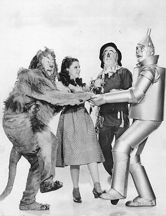 Adrian (costume designer) - Adrian's costume designs for The Wizard of Oz (1939), L-R: Bert Lahr, Judy Garland, Ray Bolger, and Jack Haley